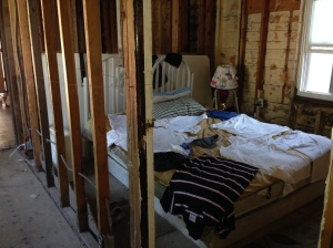 Inside of the house he is living in.