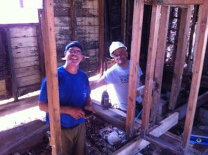 Enrique and I putting in the plumbing in his house.
